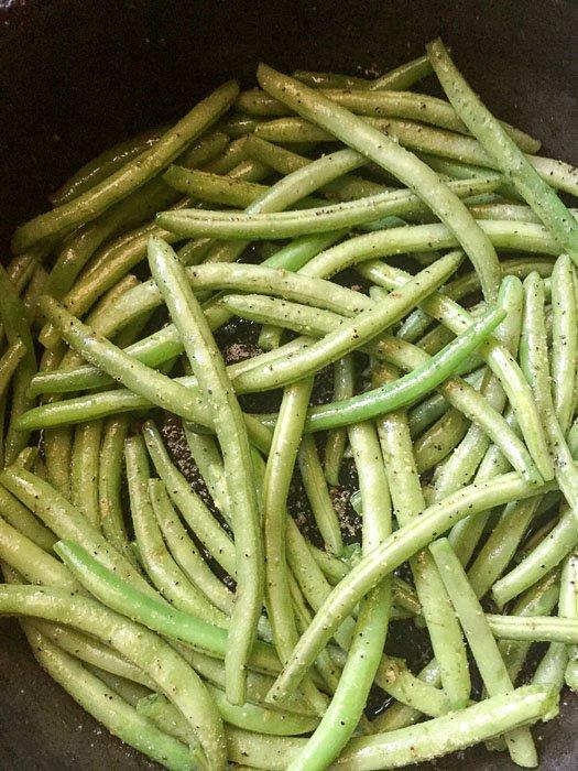 seasoned green beans cooking in pan