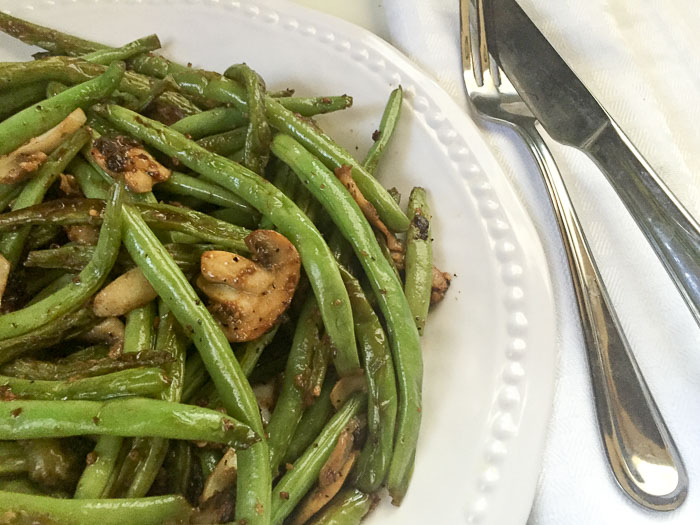 sauteed green beans and mushrooms on plate