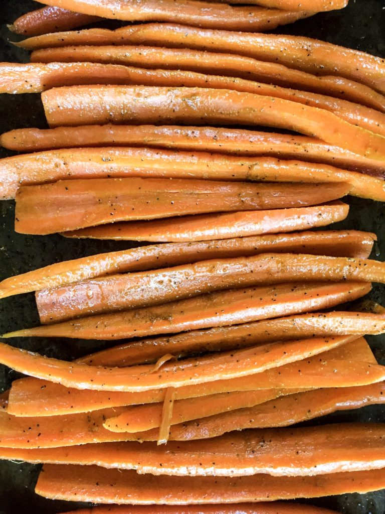 carrots tossed with olive oil and rubbed with powdered ginger and curry powder