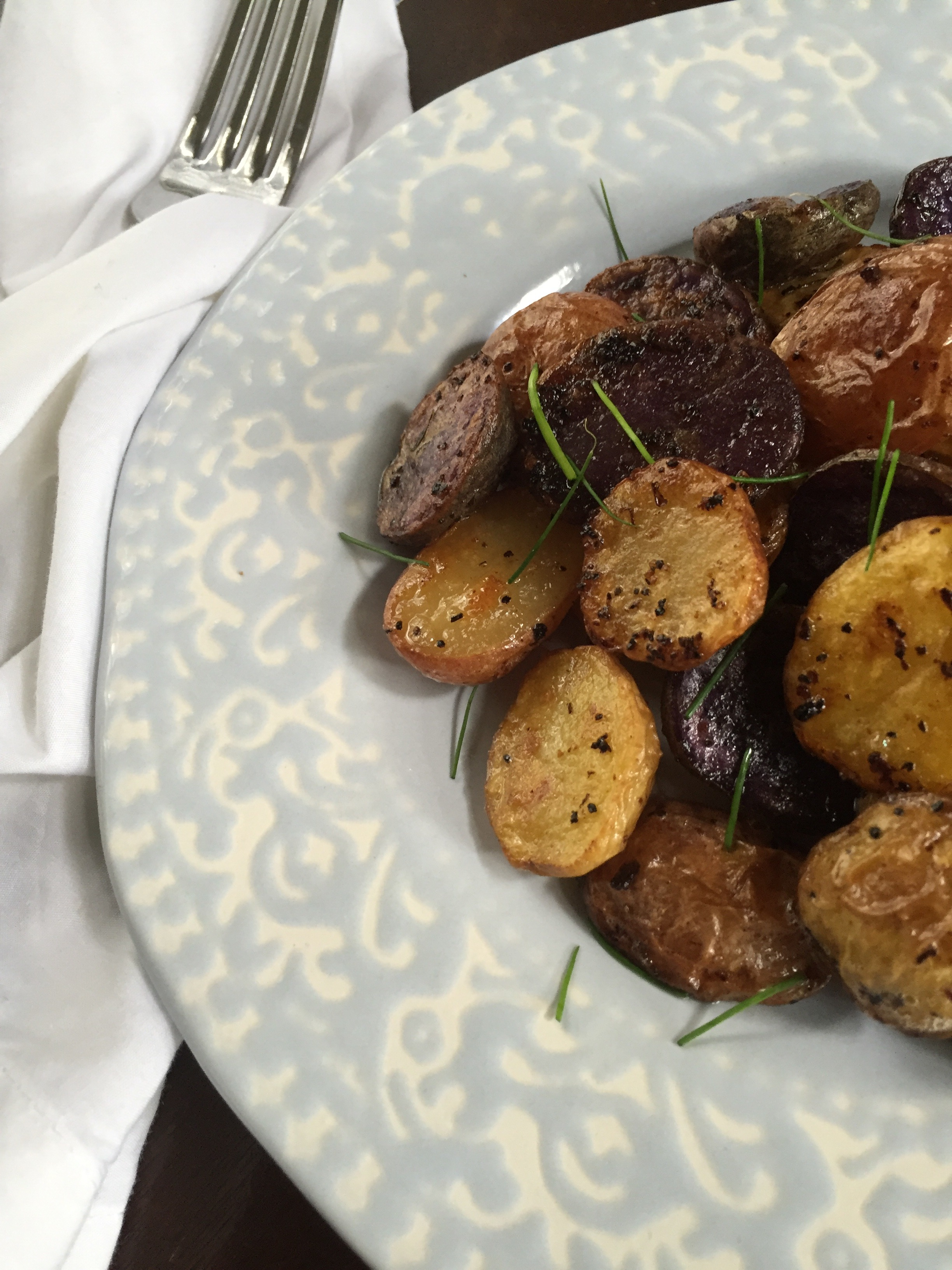 summery lemon garlic potatoes on plate