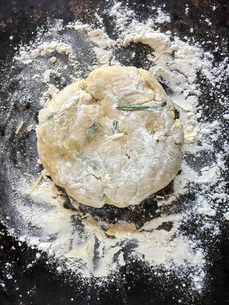 tart crust with fresh herbs and parmesan cheese