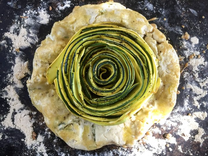 This veggie rose tart is a simple and savory appetizer made with sliced squash arranged in the shape of rose petals on top of an herbed, all-butter crust. Recipe by Dash of Jazz