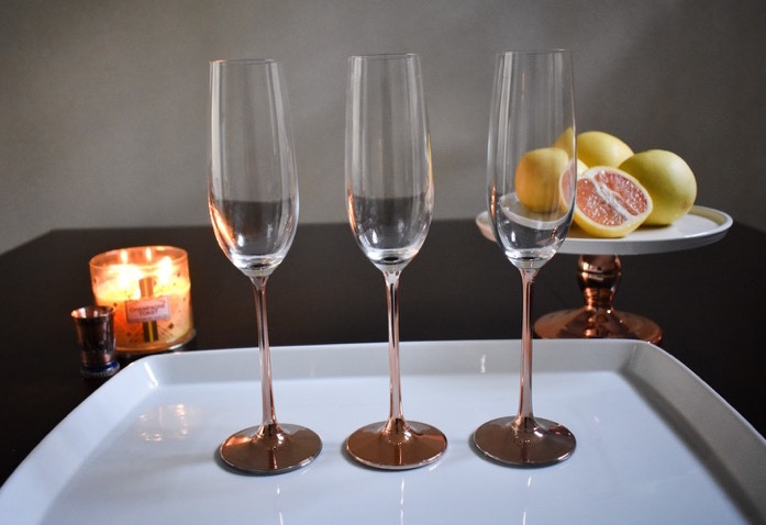 three rose gold champagne flutes
