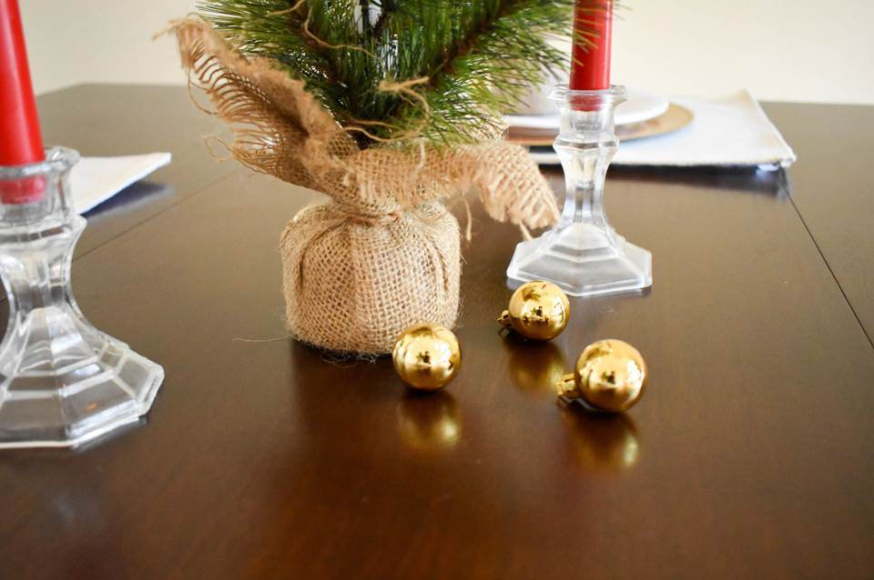 mini gold ornaments on table