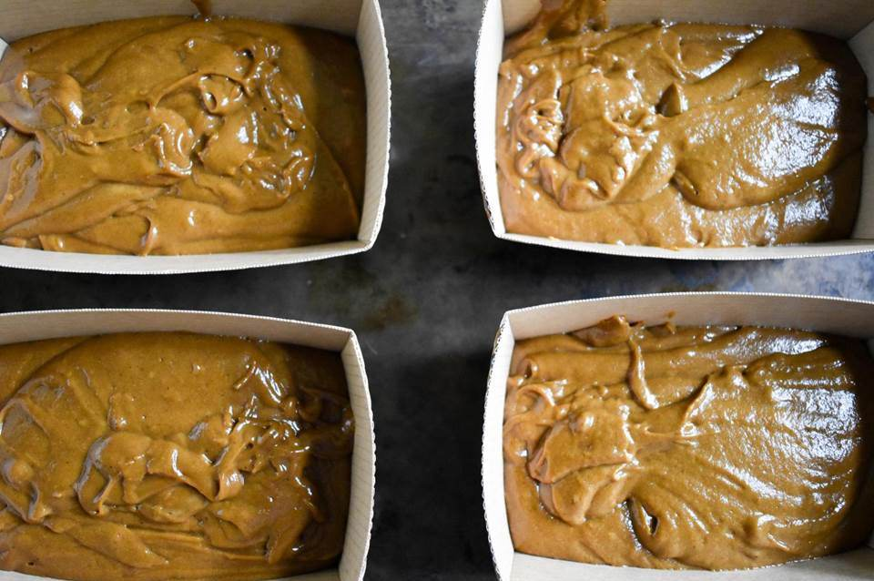 gingerbread batter in mini paper loaf pans