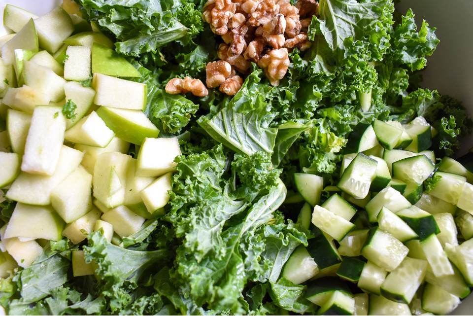 kale, walnuts, chopped cucumber, and chopped green apple