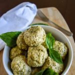 Make these pesto parmesan meatballs easily in your slow cooker for a flavorful dinner or appetizer. Recipe by Dash of Jazz