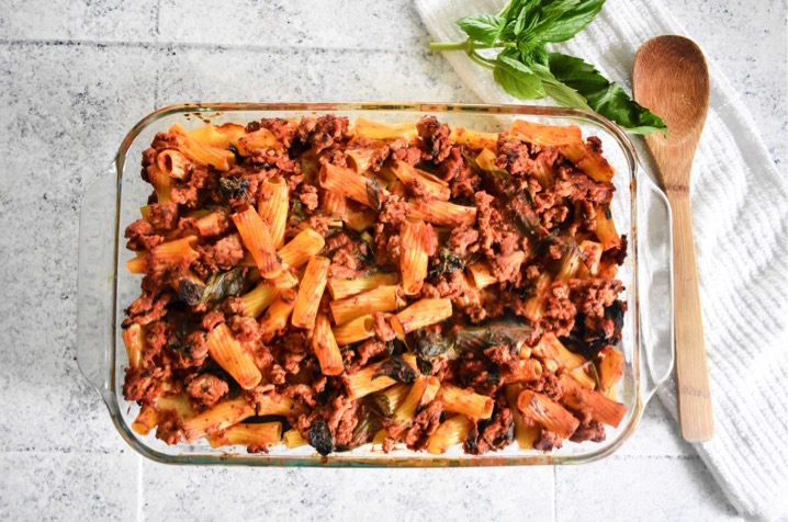 pan of baked pasta with meat sauce, cheese, and vegetables
