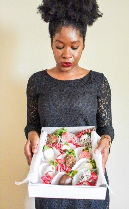 Dash of Jazz holding DIY chocolate covered strawberries box