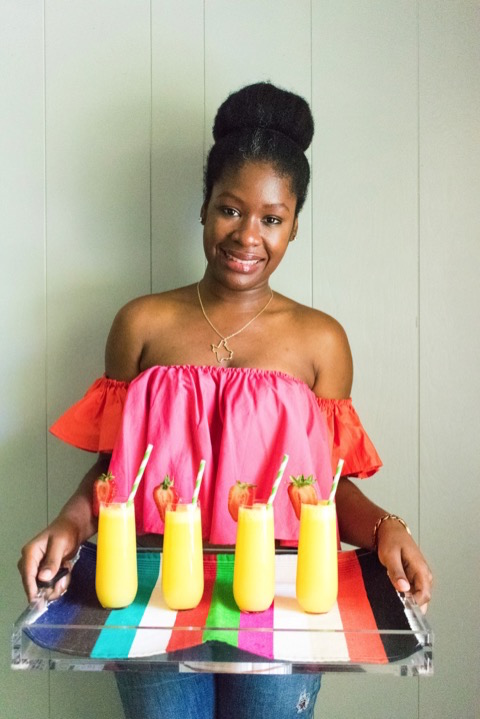 Dash of Jazz holding tray of four tequila mimosas
