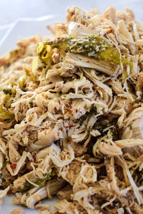 Slow Cooker Spicy Shredded Chicken perfect for adding to casseroles, tacos, and more made easily in a crock pot. Recipe by Dash of Jazz