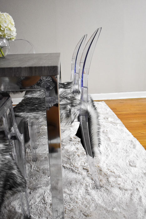 side view of ghost chairs with gray faux fur seat covers