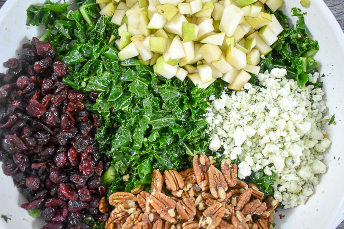 massaged kale, dried cranberries, chopped pears, pecans, and crumbled blue cheese salad