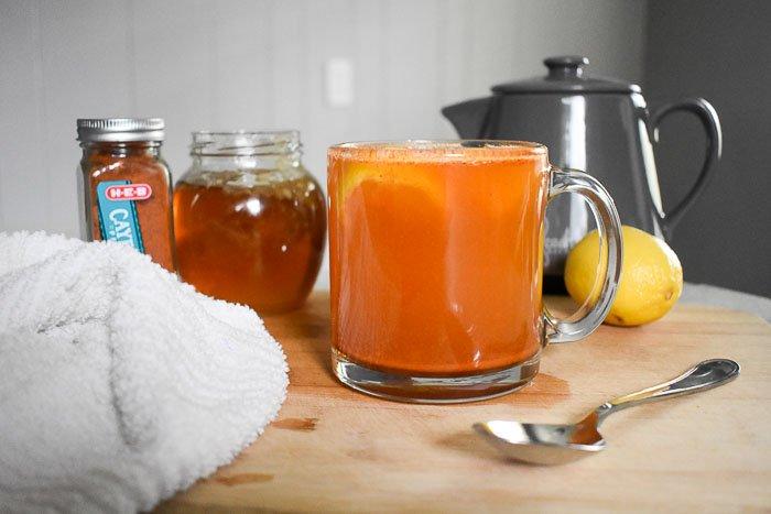 mug of cayenne pepper tea on cutting board