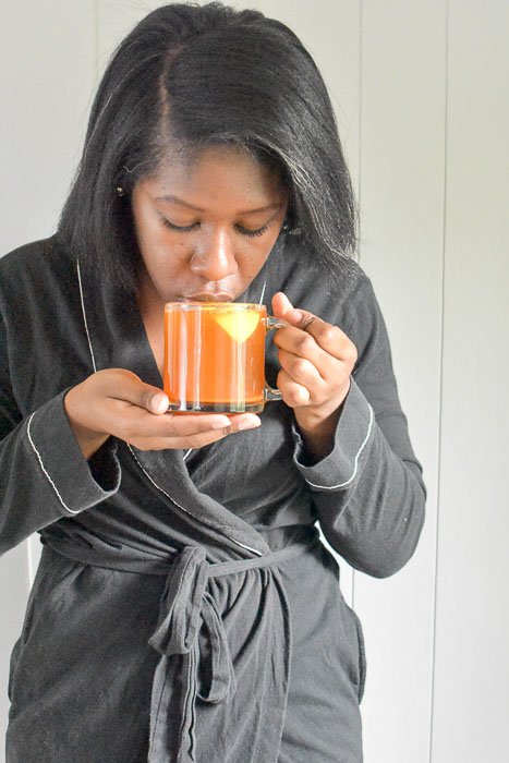 Dash of Jazz sipping mug of 4-ingredient feel-better tea made of lemon, honey, cayenne, and water
