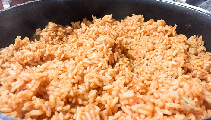 Closeup on a finished pot of Nigerian jollof rice