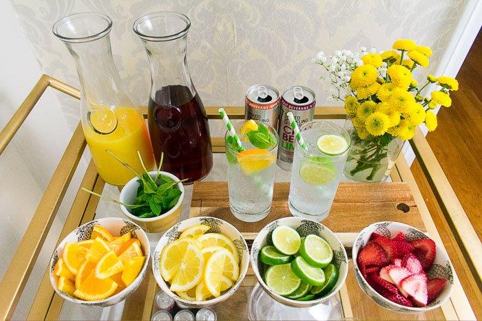 DIY drink station with fresh fruit, mint, fruit juices, and smirnoff spike sparkling seltzer