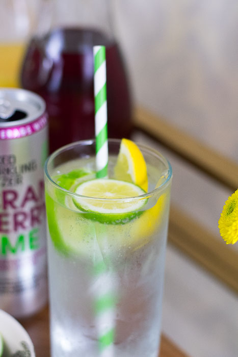 mixed drink with fresh fruit and smirnoff spiked sparkling seltzer