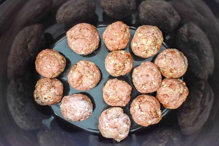 raw turkey meatballs in crock