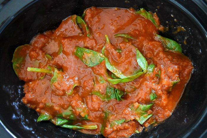 fresh baby spinach in marinara sauce