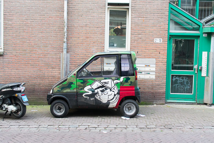small car in alleyway in central Amsterdam, The Netherlands
