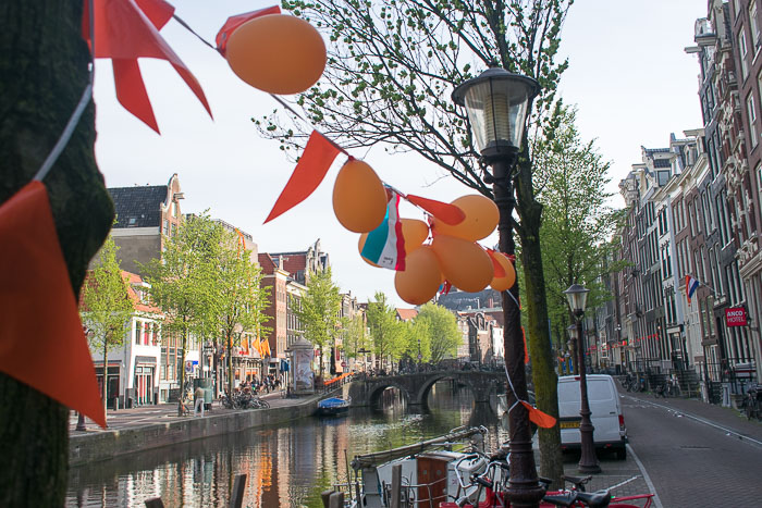 Orange balloons and streamers decorate the canals of central Amsterdam, The Netherlands for King's Day