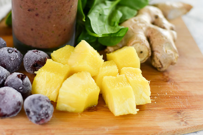 frozen cherries, pineapple, fresh ginger, and baby spinach leaves