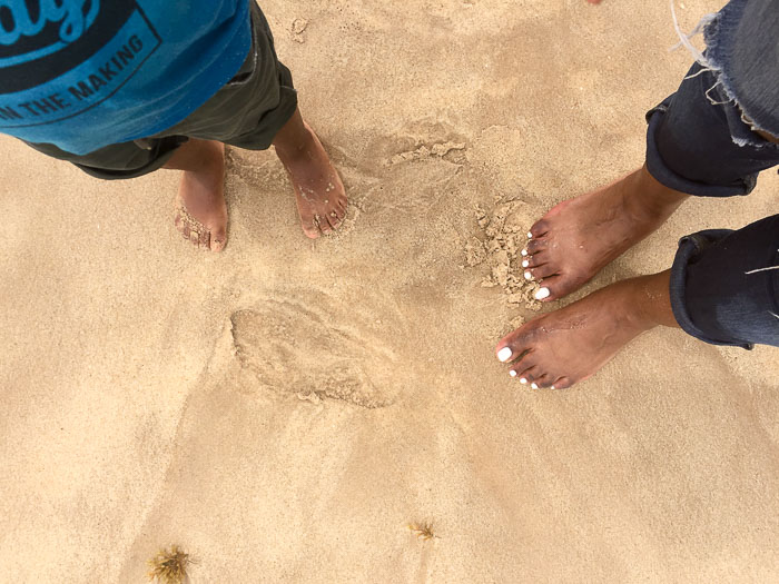 feet in sand at Elegushi Beach, Lekki, Lagos, Nigeria