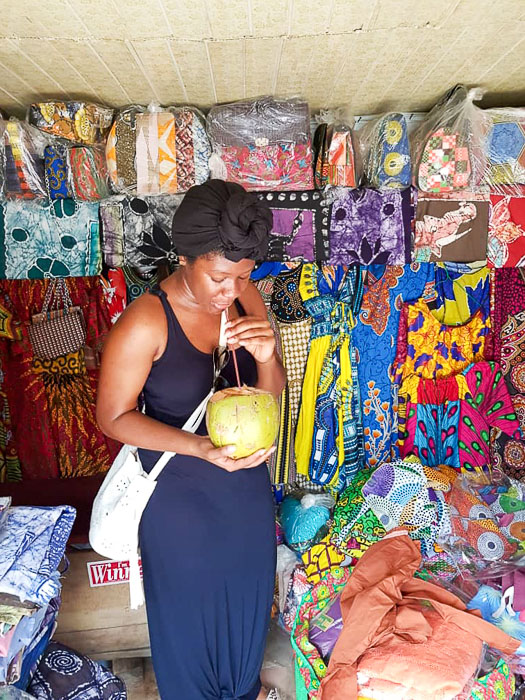 Dash of Jazz drinking fresh coconut water at Lekki Market, Lagos, Nigeria