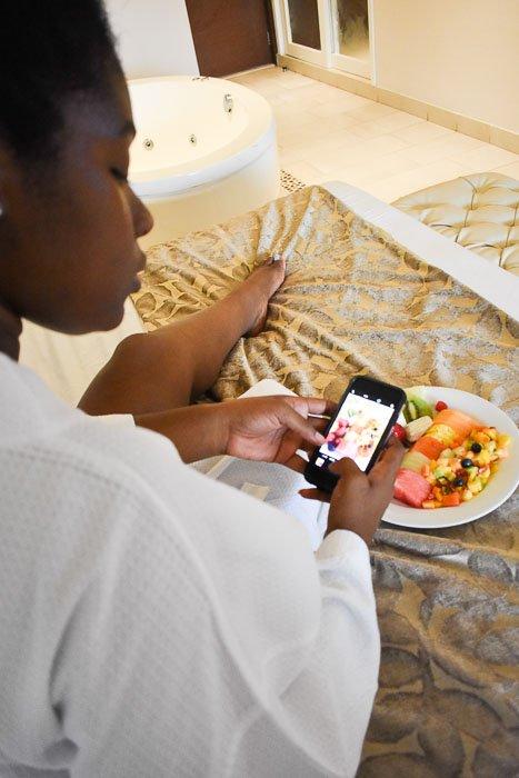 Dash of Jazz taking iPhone photo of fruit plate