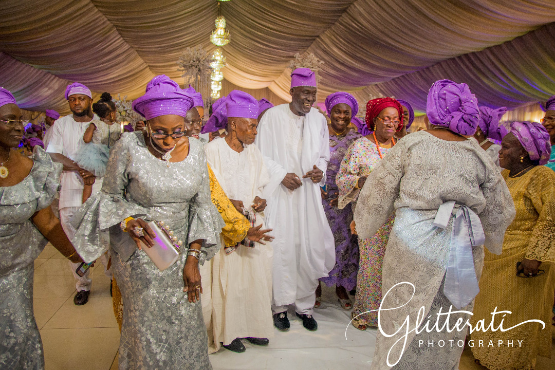 family celebrating at Yoruba wedding in Ikeja, Lagos, Nigeria