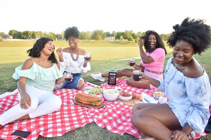 women laughing at picnic