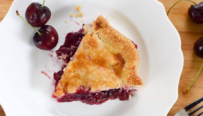 slice of lemon ginger cherry pie on plate