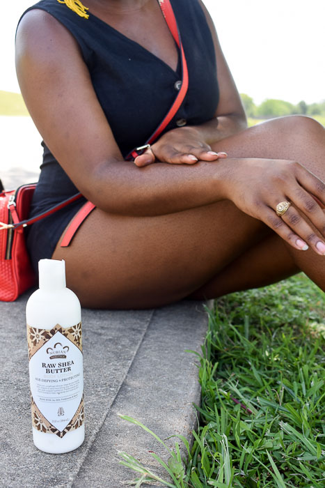 bottle of Nubian Heritage raw shea butter body lotion