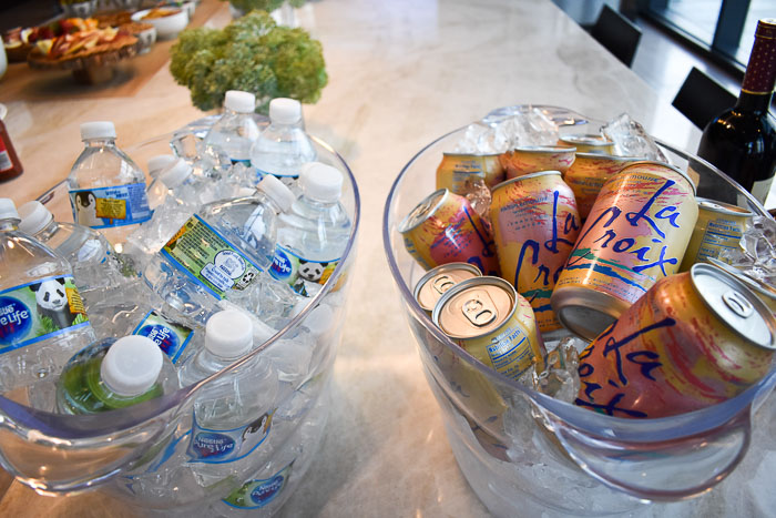 acrylic beverage tubs filled with la croix and bottled water