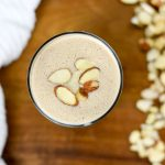 almond breakfast smoothie topped with sliced almonds
