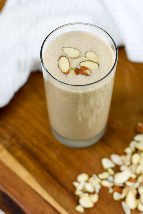 tall glass full of autumn almond breakfast smoothie