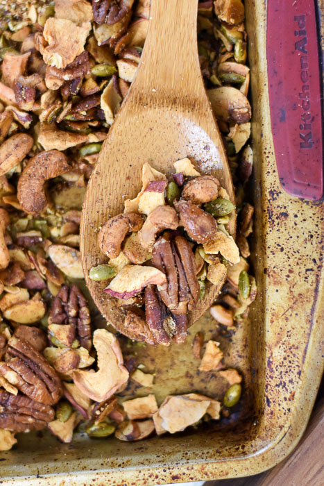 grain-free apple cinnamon granola on wooden spoon