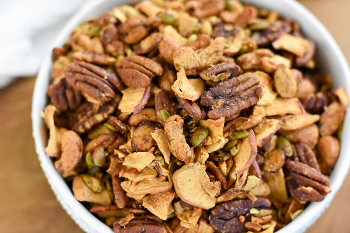 bowl overflowing with delicious apple cinnamon grain free granola