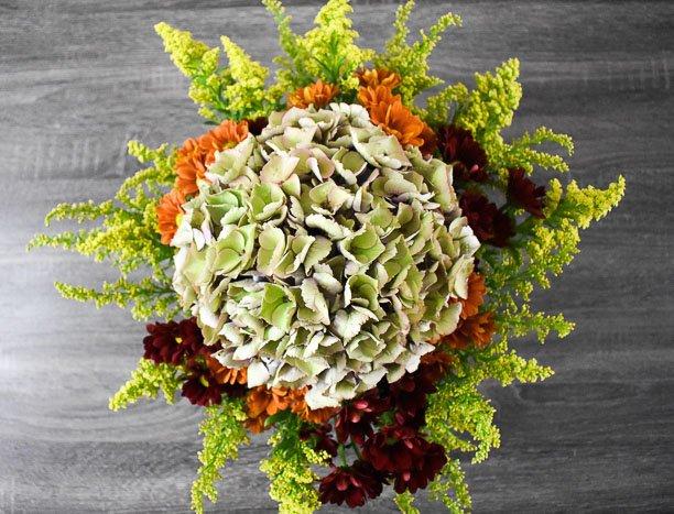 antique hydrangea, pom pons, and goldenrod floral arrangement