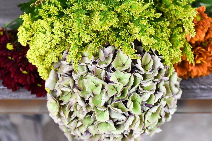 fall flowers antique hydrangea, yellow asters, goldenrod, maroon pom pons, orange pom pons