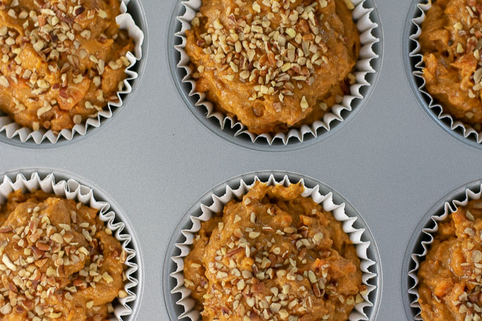 sweet potato gingerbread muffin batter in 6-count muffin pan