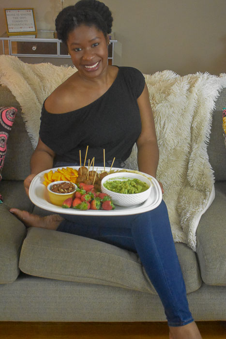 Dash of Jazz holding tray of watch party appetizers