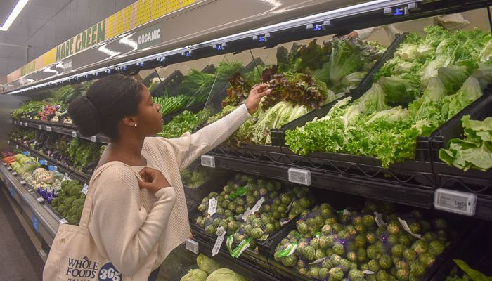 Dash of Jazz shopping for leafy greens in produce section