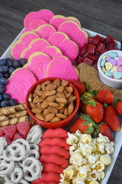 treats on a Valentine's themed dessert board