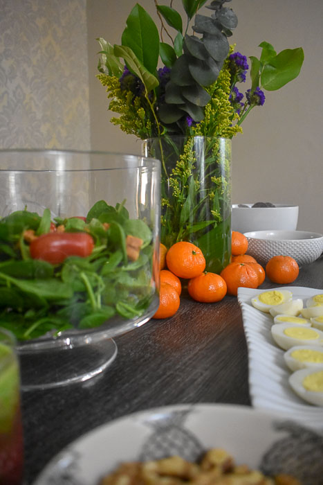 healthy brunch foods and vase of flowers on table