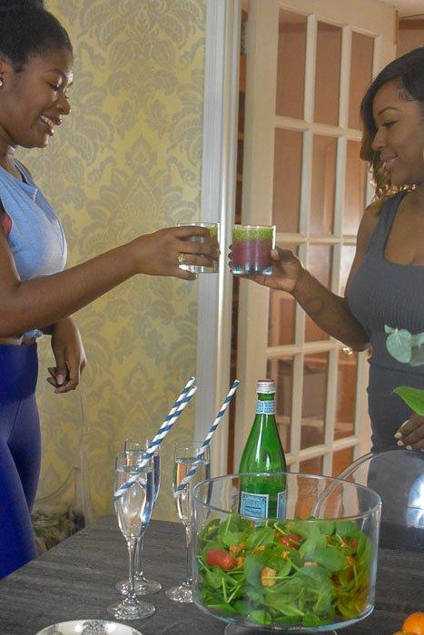 black women toasting layered smoothies