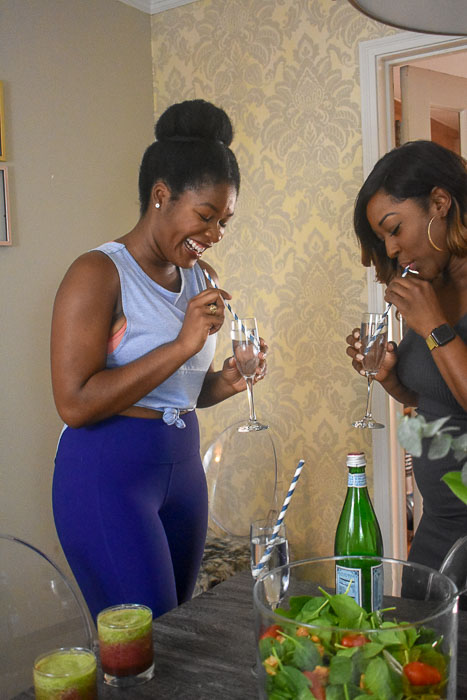 black women sipping sparkling water