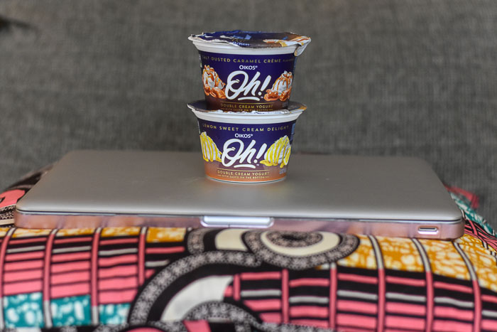 Oikos Oh! stacked on top of laptop