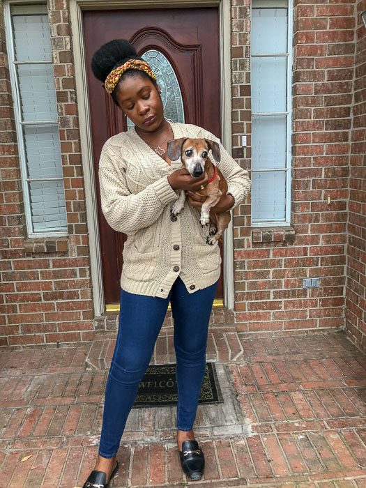Dash of Jazz holding JoJo red miniature dachshund
